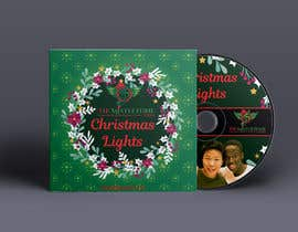 #51 for FAST turnaround - Christmas Jazz CD design using attached templates, PROVIDE editable graphic (replace photo later) by eybratka