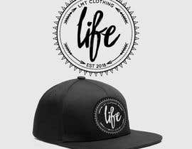#18 for Need logo for women snapback cap. Im adding logo what is going for men design. Dont need to write REVERSE on that. Just let your imagination fly and do something cool.   Must be on logo  LMT CLOTHING or just LMT EST 2018 by jamesmahoney98