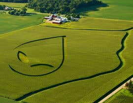 J2CreativeGroup tarafından PHOTOSHOP!  I need an ALIEN logo photoshopping into a corn field!! için no 11