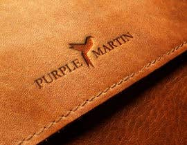 "lev200900 tarafından Design a logo for a leather brand ""Purple Martin"" için no 52"