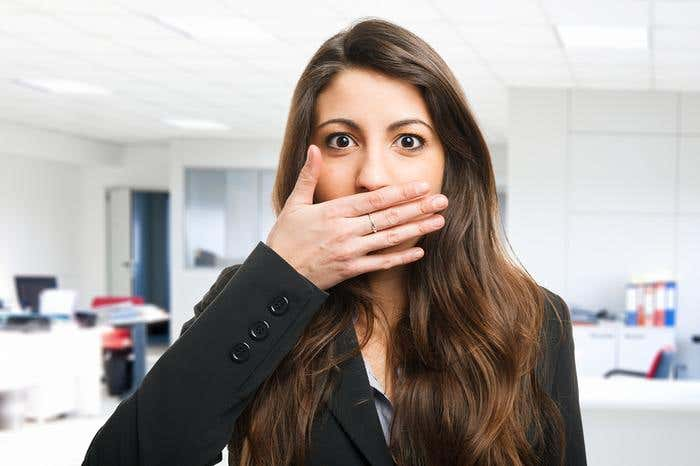 bigstock-Woman-shutting-her-mouth-42928936