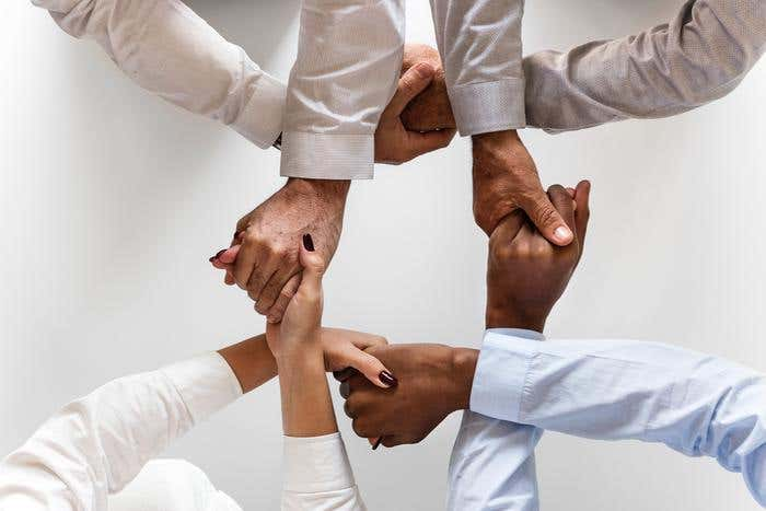Freelancers hold hands to build strong network